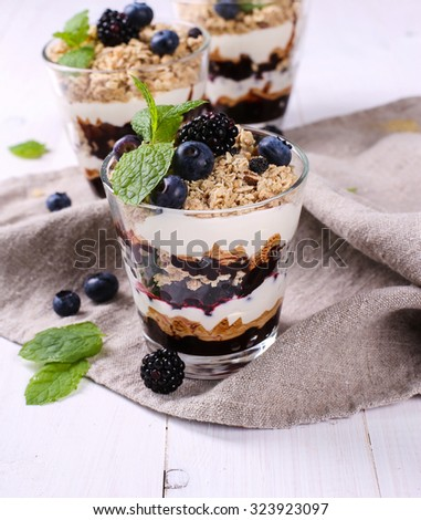 Healthy food. Delicious muesli dessert with blueberry - stock photo