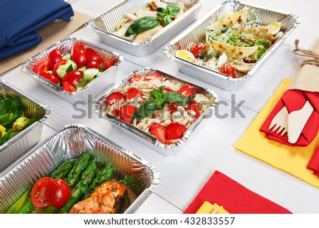 Healthy food delivery. Take away of natural organic low carb diet. Eat right concept, healthy food, clean food take away in aluminium boxes and bag, vegetables and salmon closeup - stock photo
