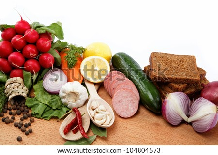 Healthy food. Fresh vegetables and fruits on a wooden board. - stock photo