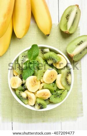 Healthy food fruit salad from kiwi and banana - stock photo