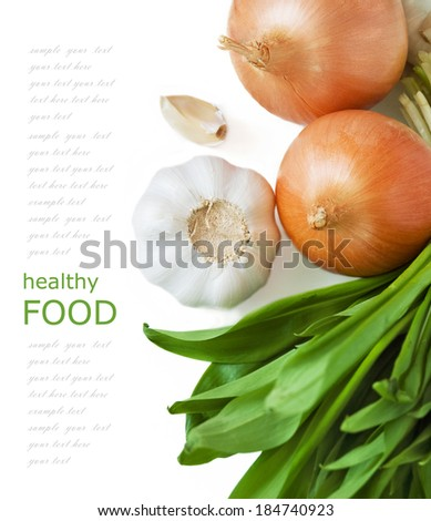 Healthy food (garlic with fresh green leaves and onion isolated on white background with sample text) - stock photo