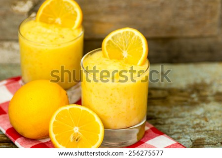 Healthy food, lemon smoothie with lemon fruits on the wooden background - stock photo