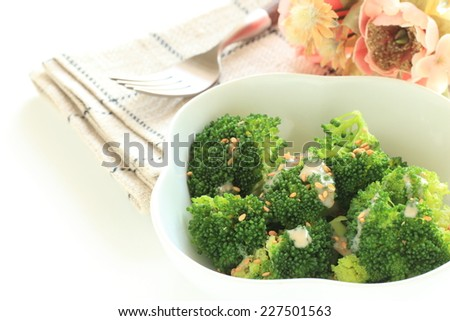 healthy food, steamed broccoli with sesame dressing - stock photo
