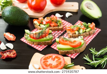 Healthy food. Vegetable appetizers. Sandwich : Rye Bread, Avocado, Tomatoes, Dill - stock photo