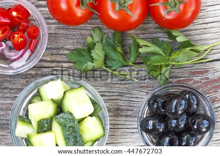 Healthy food, vegetable salad. Closeup of fresh  ingredients on a wooden table, top view - stock photo
