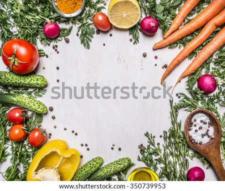 Healthy foods, cooking and vegetarian concept fresh carrots with cherry tomatoes, garlic, lemon radish, peppers, cucumbers, butter on wooden rustic background top view - stock photo