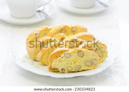Healthy fresh baked gluten free almond biscotti with white china in horizontal format - stock photo