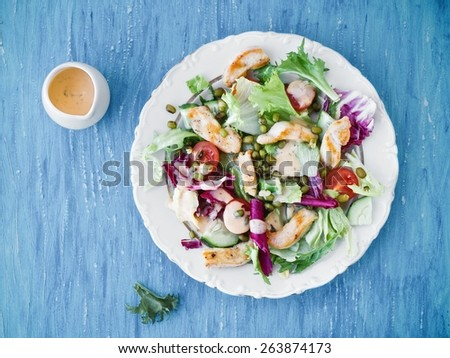 Healthy Fresh Vegetable Salad With Chicken And Sauce Top View - stock photo