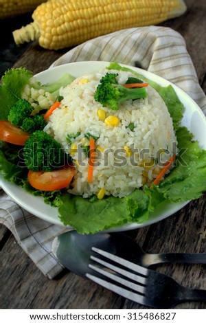 Healthy Fried Rice with broccoli, capsicum, corn, carrot and long beans - stock photo
