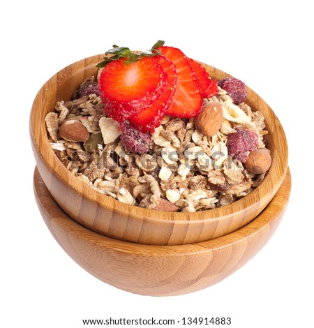 Healthy fruit and nut muesli with fresh strawberry on top - stock photo