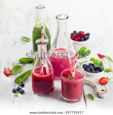 Healthy fruit and vegetable smoothies in glass bottles. Selective focus - stock photo