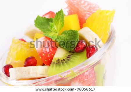 Healthy fruit salad in the glass bowl - stock photo