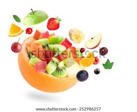 Healthy fruit salad on white background  - stock photo