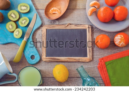 Healthy fruits and juice on wooden table. View from above - stock photo