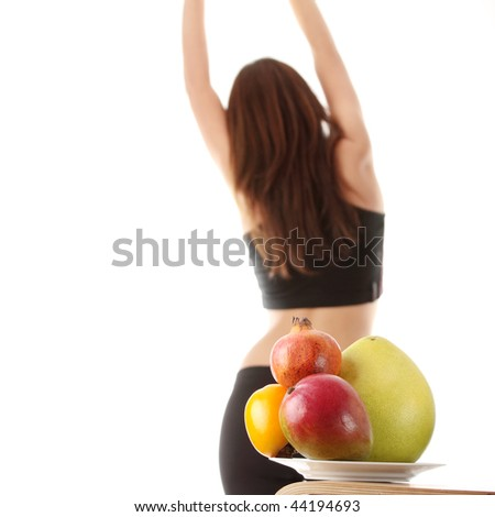 Healthy fruits with fitness girl in background, isolated o white - stock photo