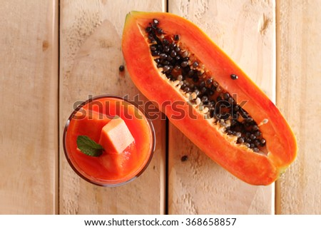 healthy fruity smoothie with papaya in a glass, top view  - stock photo