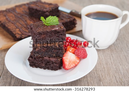 Healthy gluten free brownies made with sweet potato and coconut flour. Paleo style brownies on a wooden table, selective focus - stock photo