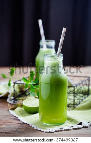 Healthy green juice with fresh vegetable and fruit - stock photo