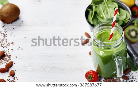 Healthy green smoothie and ingredients on white  - superfoods, detox, diet, health, vegetarian food concept. Background layout with free text space. - stock photo