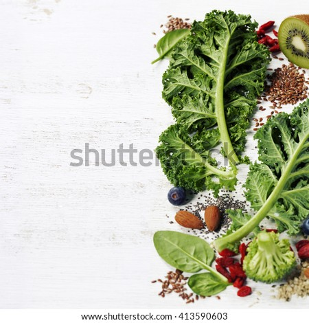 Healthy green smoothie or salad ingredients on white - superfoods, detox, diet, health or vegetarian food concept - stock photo