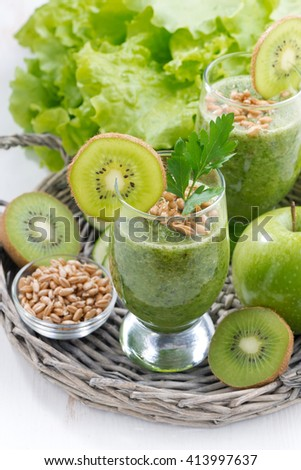 healthy green smoothie with sprouts and fresh ingredients, vertical, top view - stock photo