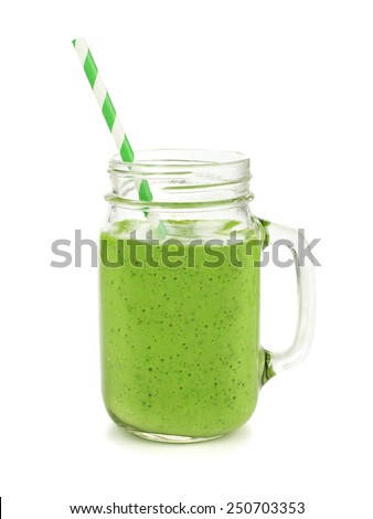 Healthy green smoothie with straw in a jar mug isolated on white - stock photo