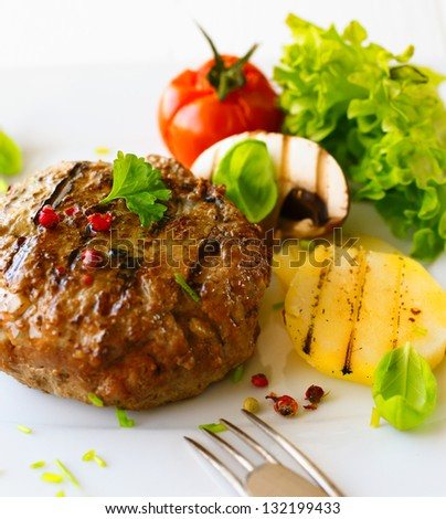 Healthy grilled patty and vegetable in a close up shot - stock photo