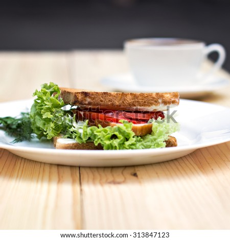 Healthy ham sandwich with cheese, tomatoes and lettuce - stock photo