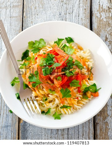Healthy ham tomato and red pepper pasta - stock photo