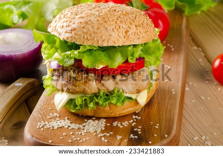 Healthy hamburger with fresh vegetables. Selective focus - stock photo