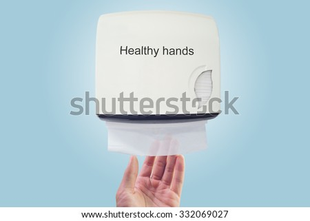 Healthy hand : use paper from dispenser - stock photo