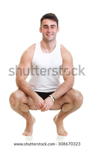 Healthy happy young man with towel isolated on white background - stock photo
