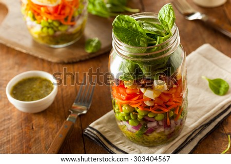 Healthy Homemade Mason Jar Salad with Egg Bacon Lettuce and Veggies - stock photo