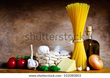 Healthy italian cooking ingredients for pasta spaghetti on a wooden background - stock photo