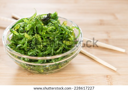 Healthy Kelp Salad in a bowl on wooden background (close-up shot) - stock photo