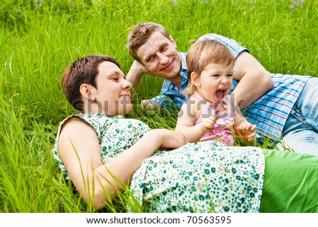 Healthy leisure time for young family - stock photo