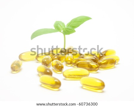 Healthy life concept - mint leaves and pills - stock photo