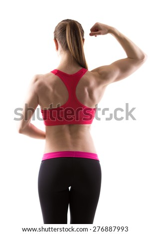 Healthy lifestyle: athletic bodybuilder girl flexing her arm, showing biceps and back muscles, rear view, studio shot, white background, isolated - stock photo