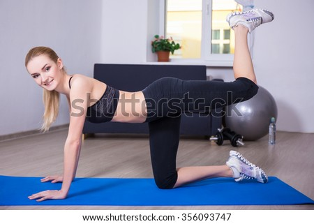 healthy lifestyle concept - slim flexible woman doing exercise on yoga mat at home - stock photo