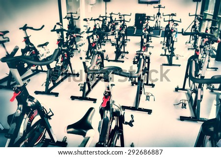 Healthy lifestyle concept. Spinning class with empty bikes - stock photo