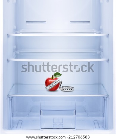 Healthy lifestyle, diet concept. Red apple with measurement  in empty refrigerator.  - stock photo