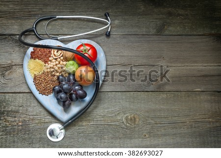 Healthy lifestyle diet concept with heart  and stethoscope - stock photo