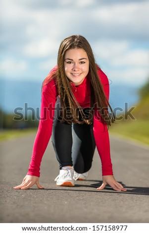 Healthy lifestyle - girl ready to run - stock photo