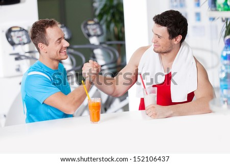 Healthy lifestyle. Two confident men in gym bar - stock photo
