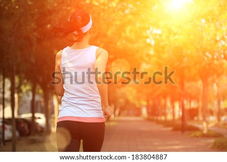 healthy lifestyle woman running at city park pavement - stock photo