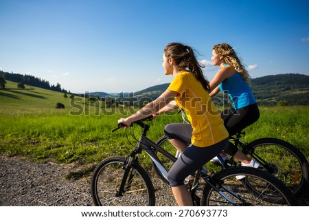 Healthy lifestyle - young women biking - stock photo