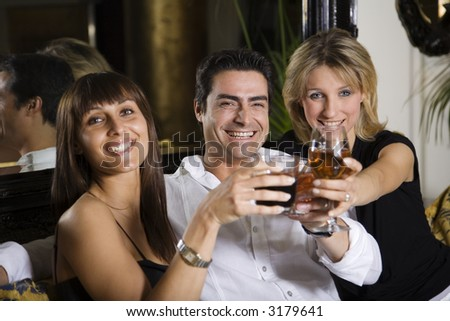 healthy living: friends at a restaurant having fun together - stock photo