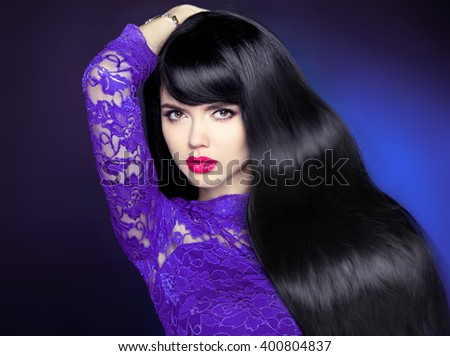 Healthy long hair. Beautiful woman with smooth shiny straight wavy hair. Hairstyle. Makeup cosmetics. Beauty fashion Studio photo. - stock photo