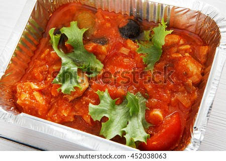 Healthy lunch and diet concept. Take away of fitness food. Weight loss nutrition in foil boxes. Hungarian lesco with tomatoes and peppers at white wood, closeup - stock photo