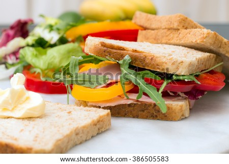 Healthy lunch food sandwich with turkey and ham on a plate - stock photo